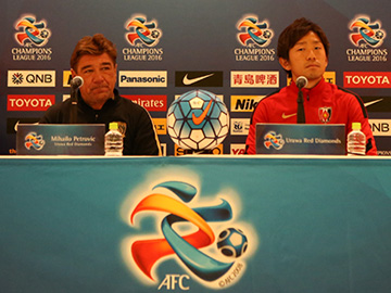 Team Manager Mischa and Player Ugajin attend official interview session before the match against Guangzhou Evergrande