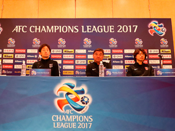 Team Manager Mischa and Player Tomoya Ugajin attend official interview session the day before the match against Shanghai SIPG F.C.